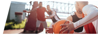adult basketball game on an outdoor court