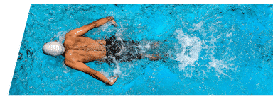 Swimmer in Club Loveland's indoor lap pool housed in the aquatic center