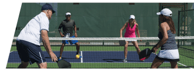 Adult pickleball game on the Club Loveland court